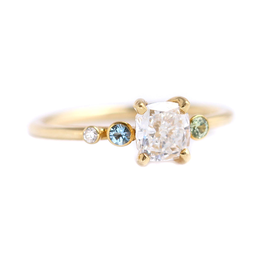 Side View Of Asymmetric Diamond Cluster Engagement Ring with Aquamarine And Mint Garnet