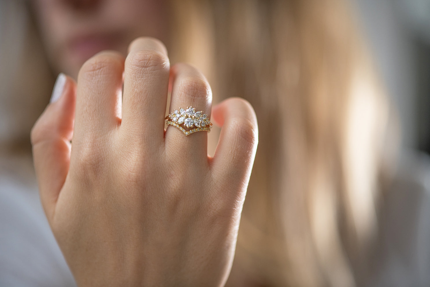 Cluster Engagement Ring with Round Diamonds on Hand