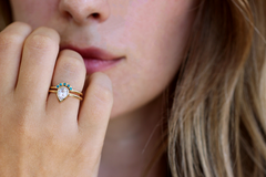 Tiny Turquoise Gemstone Ring on finger