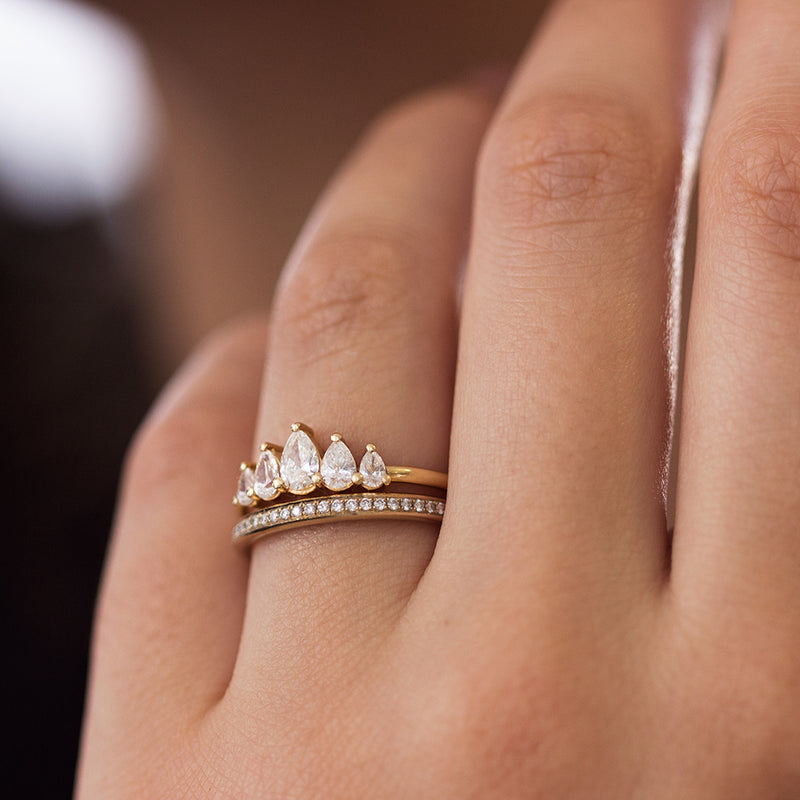 Crown Engagement Ring Set with Pear Cut Diamonds on Hand Up Close