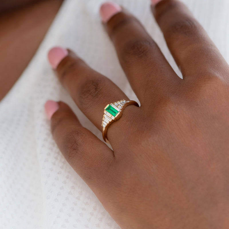Dainty-Emerald-Engagement-Ring-with-Needle-Baguette-Diamonds-side-shot