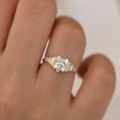 Deco Engagement Ring with Marquise Diamond on Hand up close detail shot