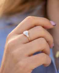 Deco-Engagement-Ring-with-Needle-Baguette-Diamonds-Pond-of-Light-Ring-side-shot