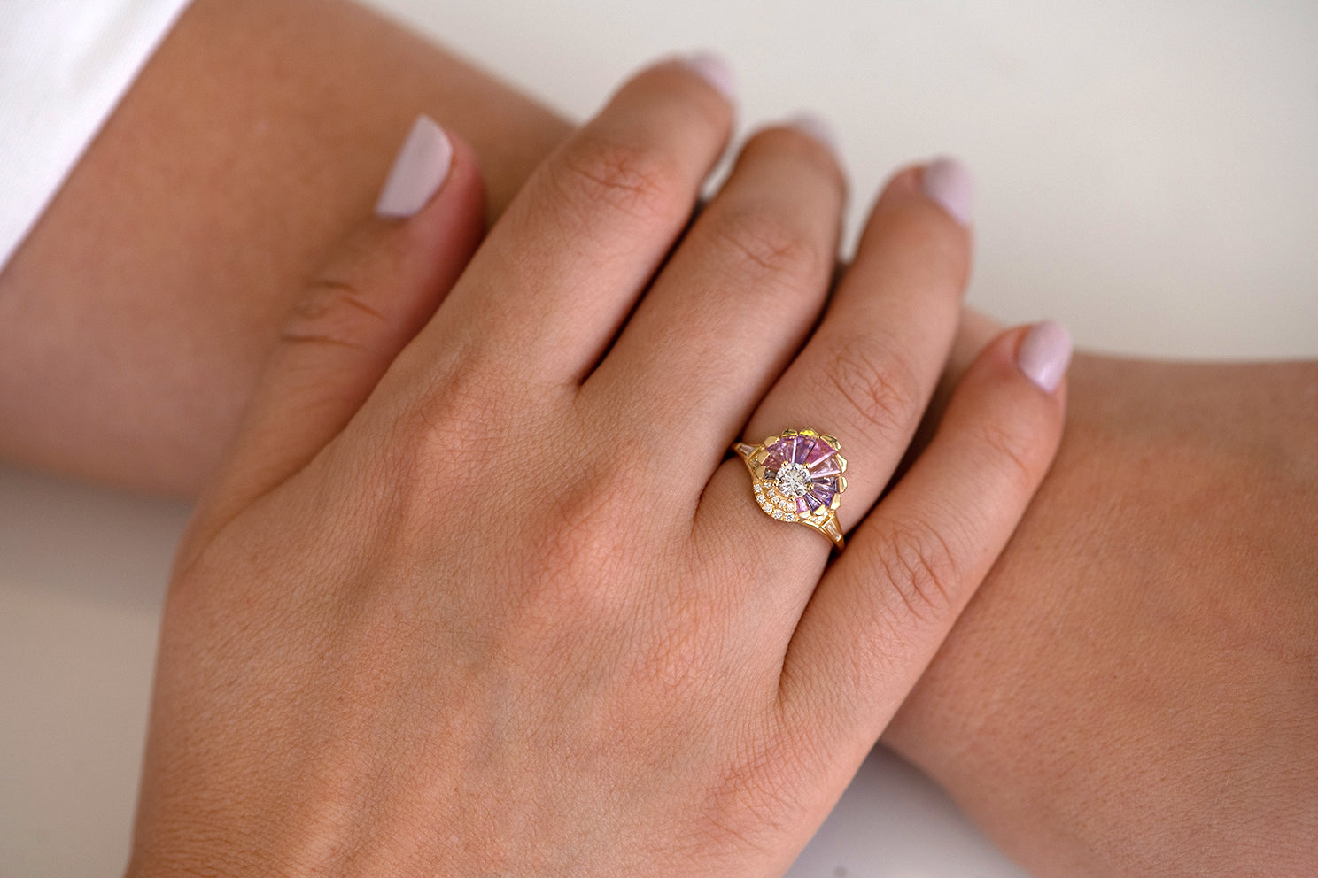Deco Engagement Ring with Purple and Lilac Sapphires on Hand top down view