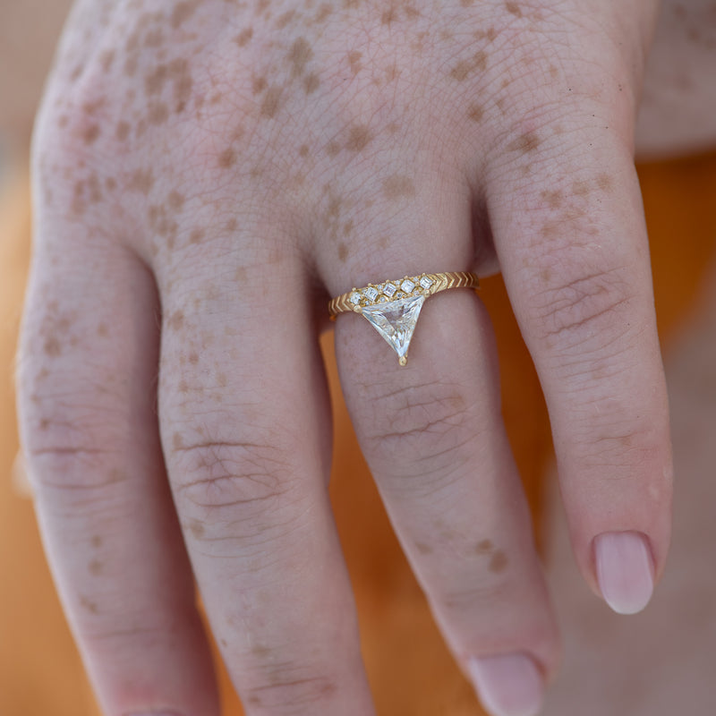 Detailed-Triangle-Diamond-Ring-with-Gold-Pattern-0.5-carat-side-shot-motion
