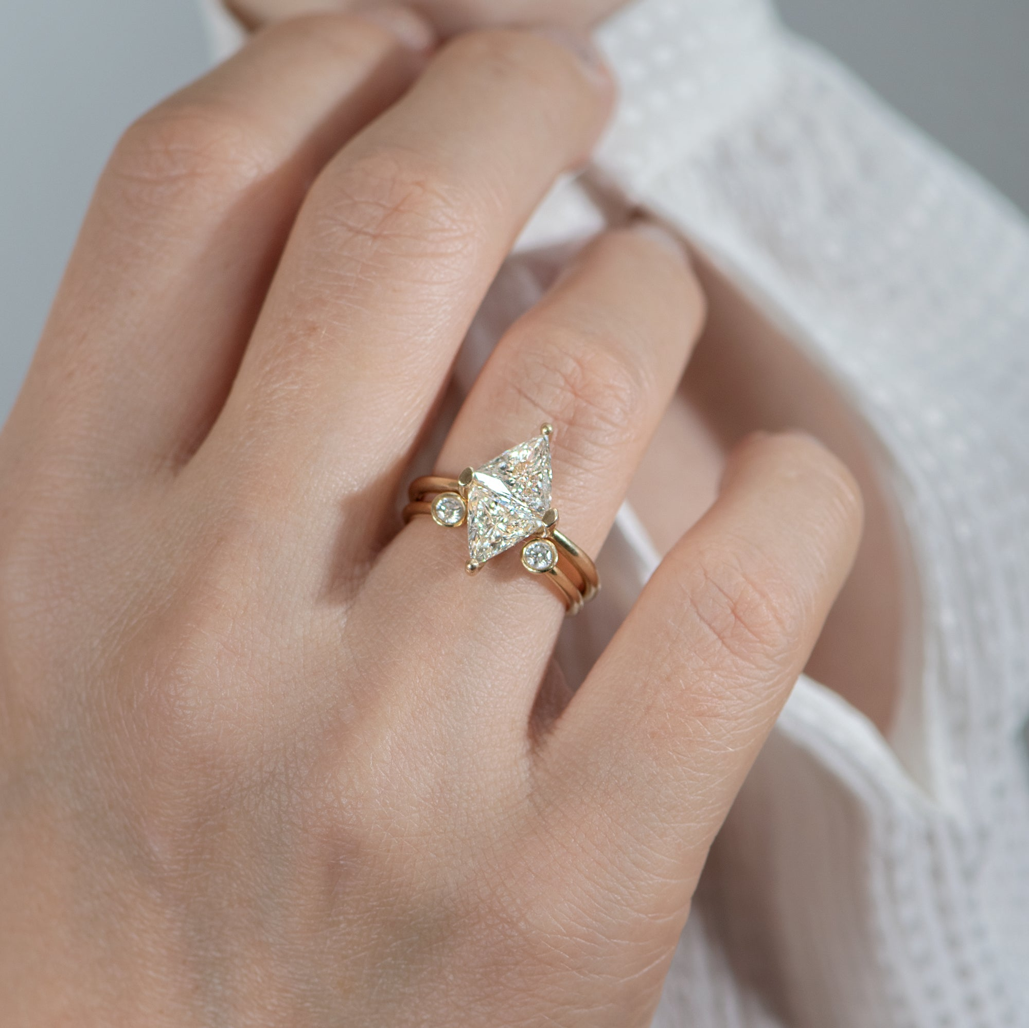 Diamond-Rhombus-Engagement-Ring-with-Triangle-Cut-Diamonds-top-shot-on-set