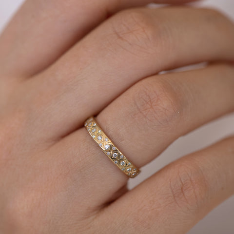 Diamond Criss Cross Wedding Band on finger