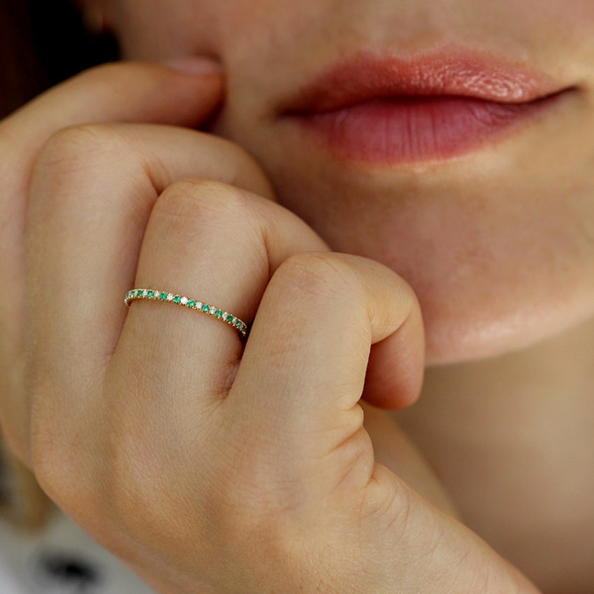 Emerald And Diamond Eternity Wedding Band On Ring Finger