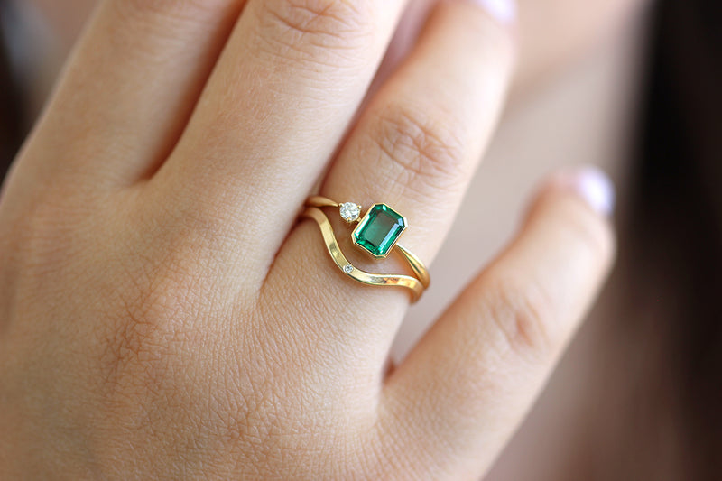 Emerald Engagement Ring with A Small Diamond In A Set