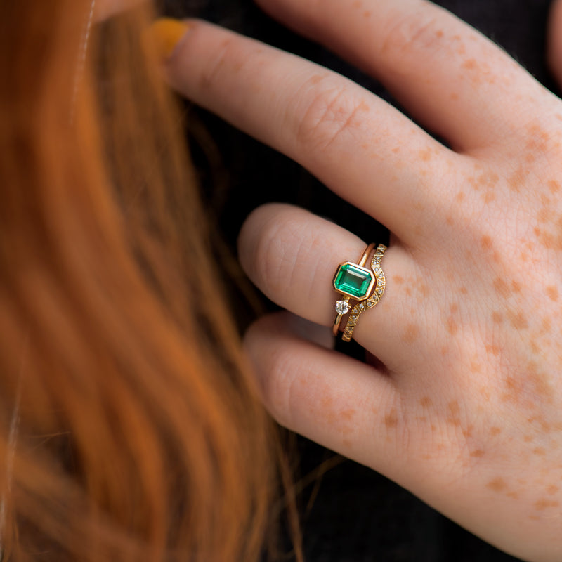 Emerald-Engagement-Ring-with-A-Small-Diamond-asymmetric-Emerald-Ring-in-set