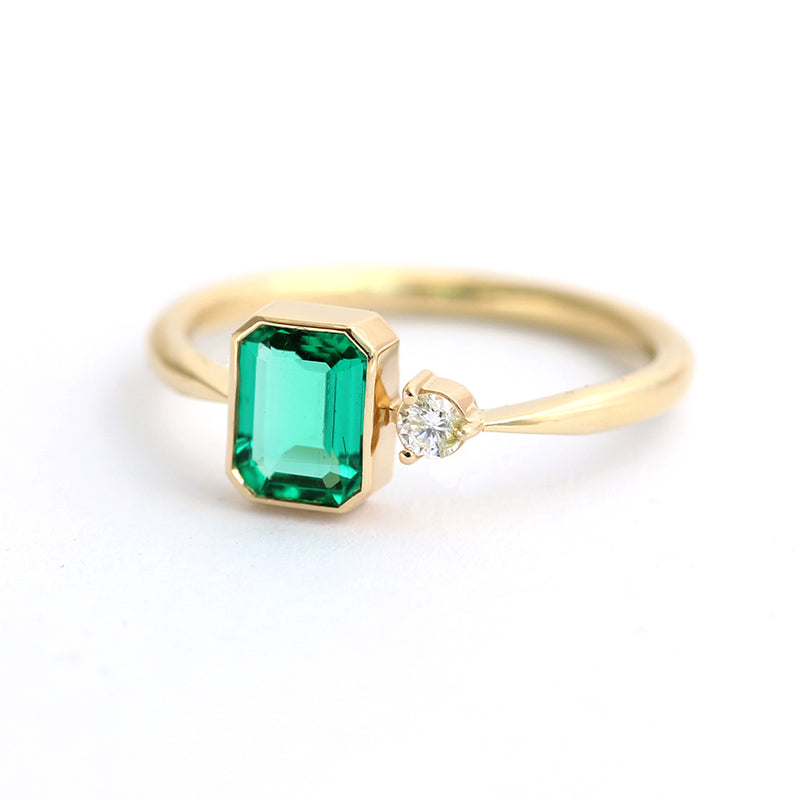 Emerald Engagement Ring with A Small Diamond