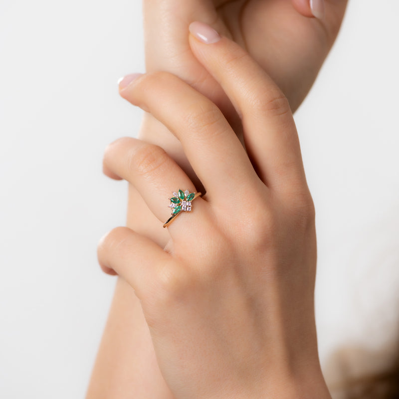 Emerald-and-Diamond-Cluster-Engagement-Ring-sparking