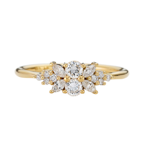 Engagement-Ring-with-a-Cluster-of-Diamonds-Small-Flora-Ring-closeup