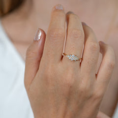 Engagement-Ring-with-a-Cluster-of-Diamonds-Small-Flora-Ring-moment-in-set