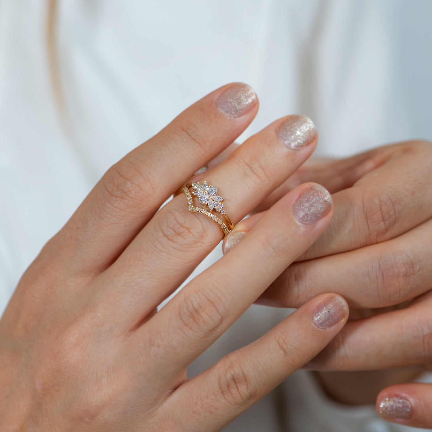 Engagement-Ring-with-a-Cluster-of-Diamonds-Small-Flora-Ring-momeny-in-set-side-shot