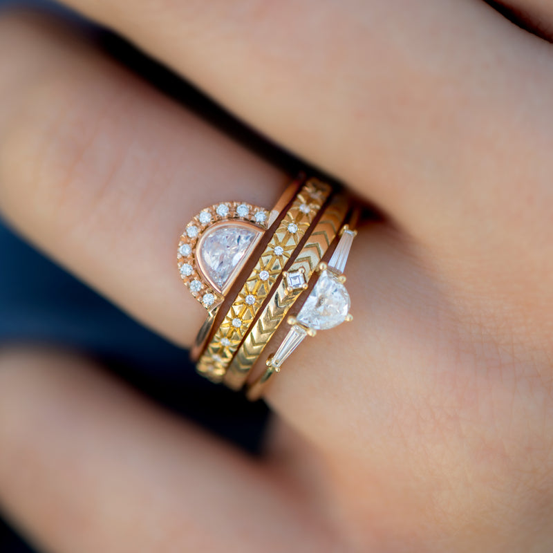Engraved-Geometric-Wedding-Ring-with-a-Carre-Diamond-closeup-in-set