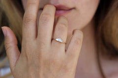 Five Baguette Diamonds Engagement Ring on finger