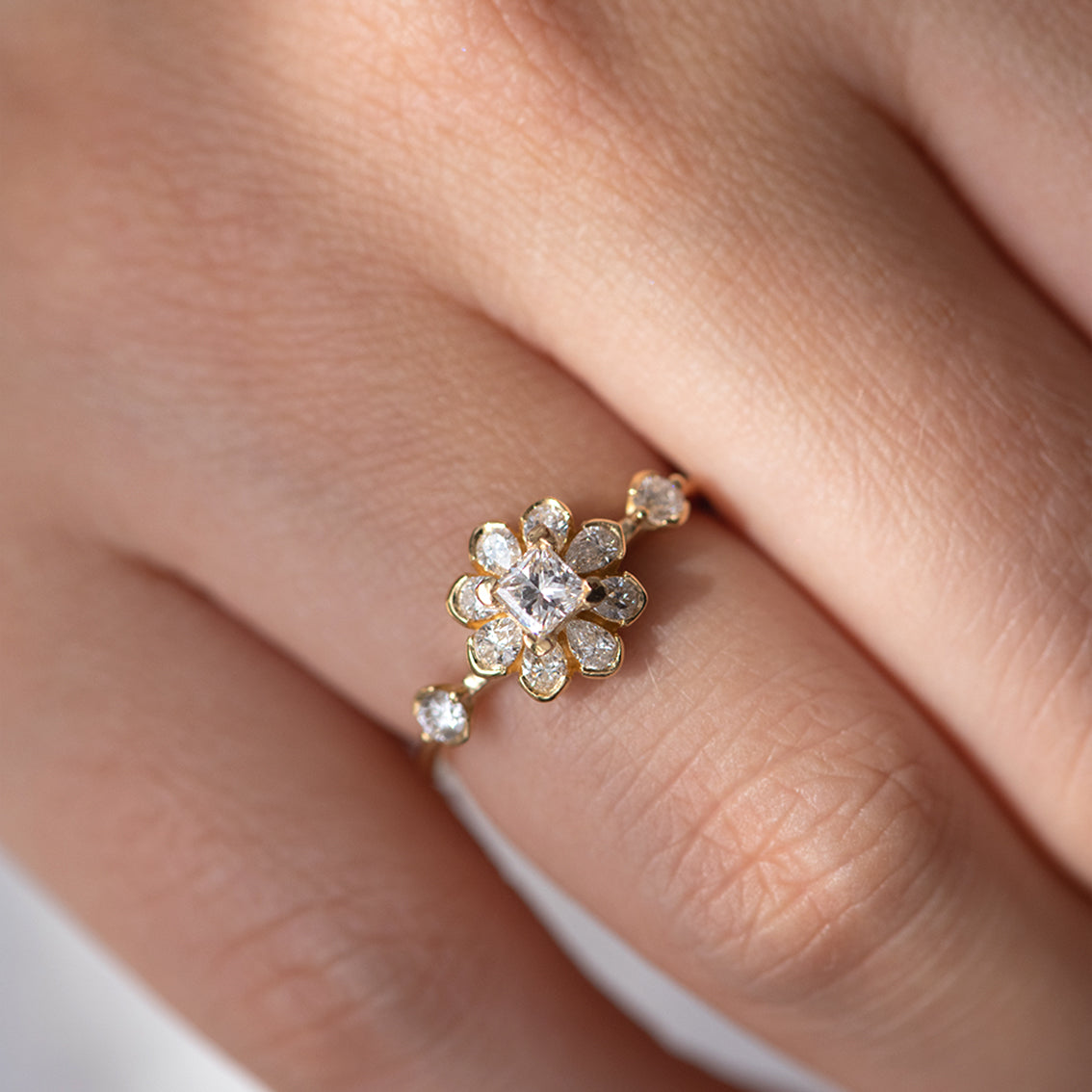 Flower Diamond Engagement Ring on finger