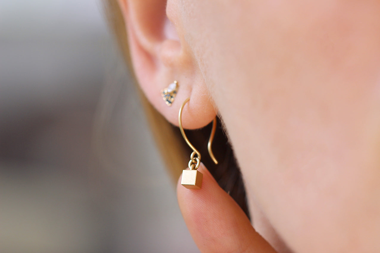 Front View Of Tiny Cube Gold Earrings