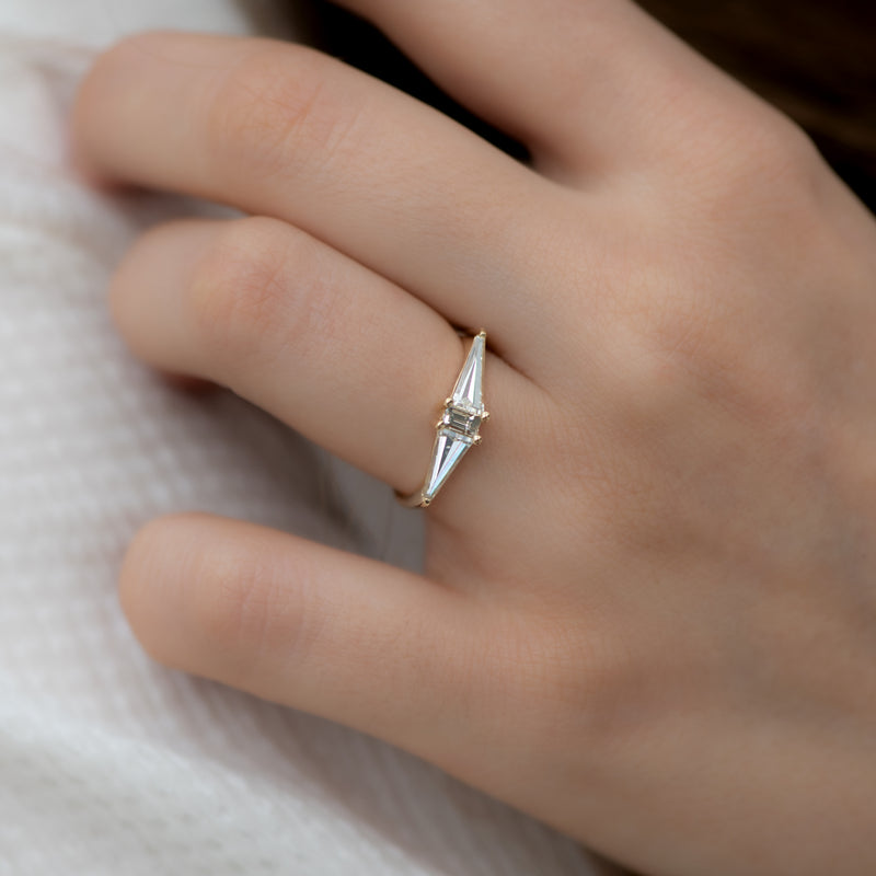 Geometric-Engagement-Ring-with-OOAK-Arrow-Diamonds-on-finger