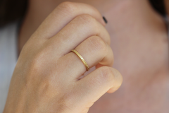 Minimalist Wedding Ring On Finger