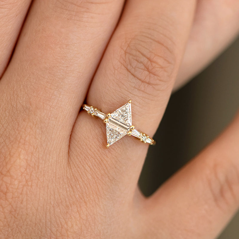Geometric Engagement Ring with Triangle and Baguette Diamonds on Hand detail shot up close