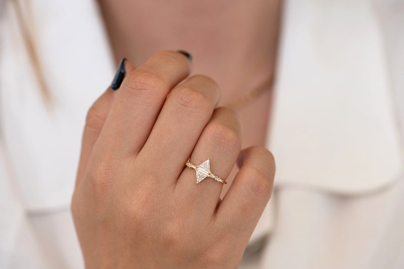 Geometric Engagement Ring with Triangle and Baguette Diamonds on Hand front view