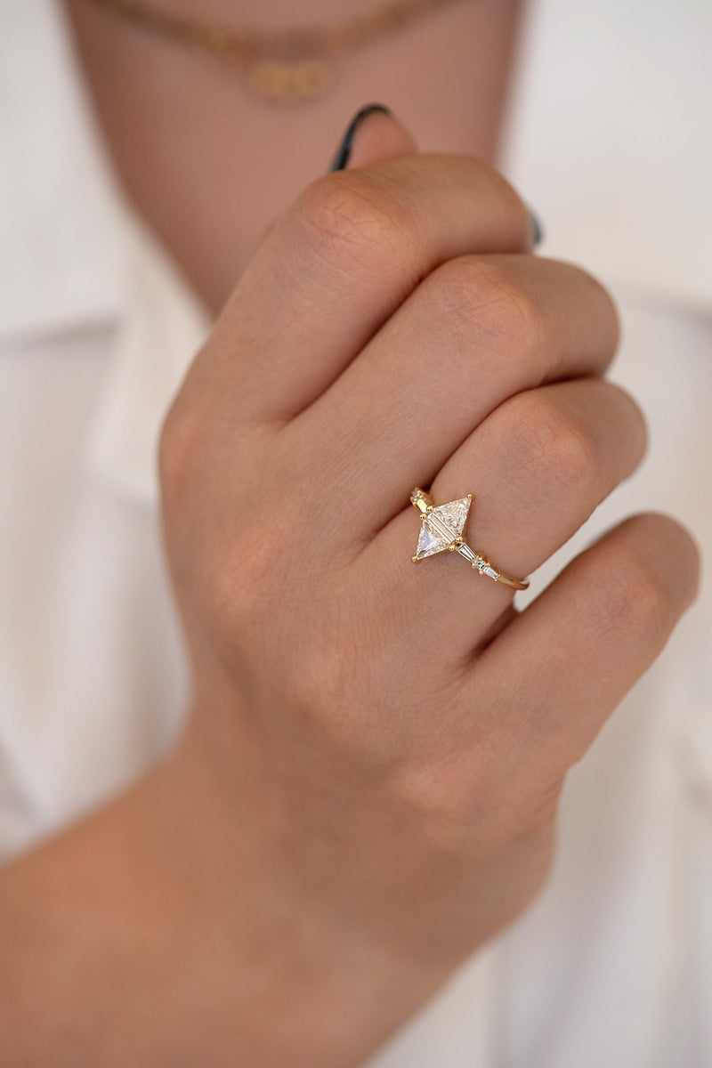 Geometric Engagement Ring with Triangle and Baguette Diamonds on Hand top angle