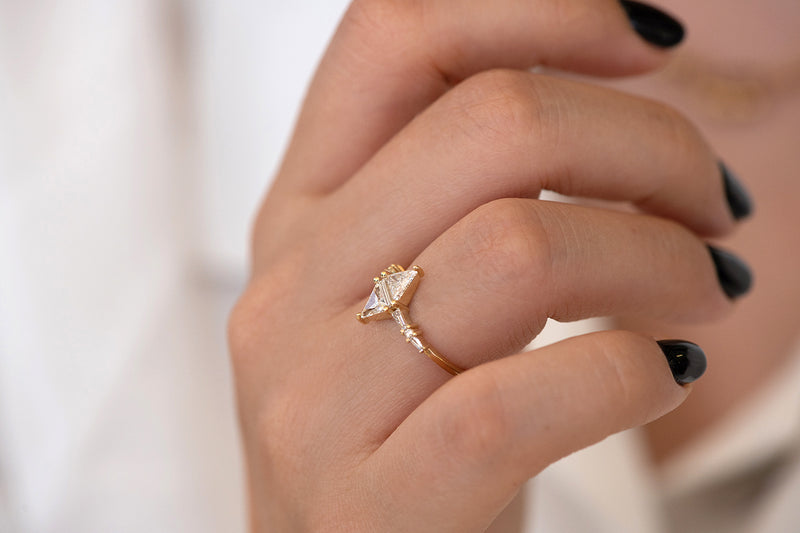 Geometric Engagement Ring with Triangle and Baguette Diamonds on Hand up close of side angle