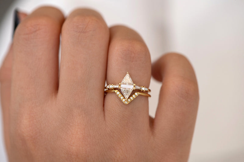 Geometric Engagement Ring with Triangle and Baguette Diamonds on Hand in set detail shot