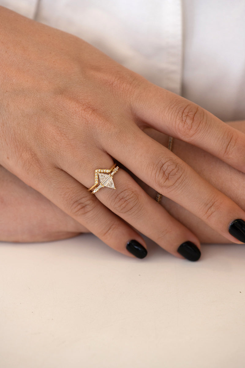Geometric Engagement Ring with Triangle and Baguette Diamonds on Hand in set front shot
