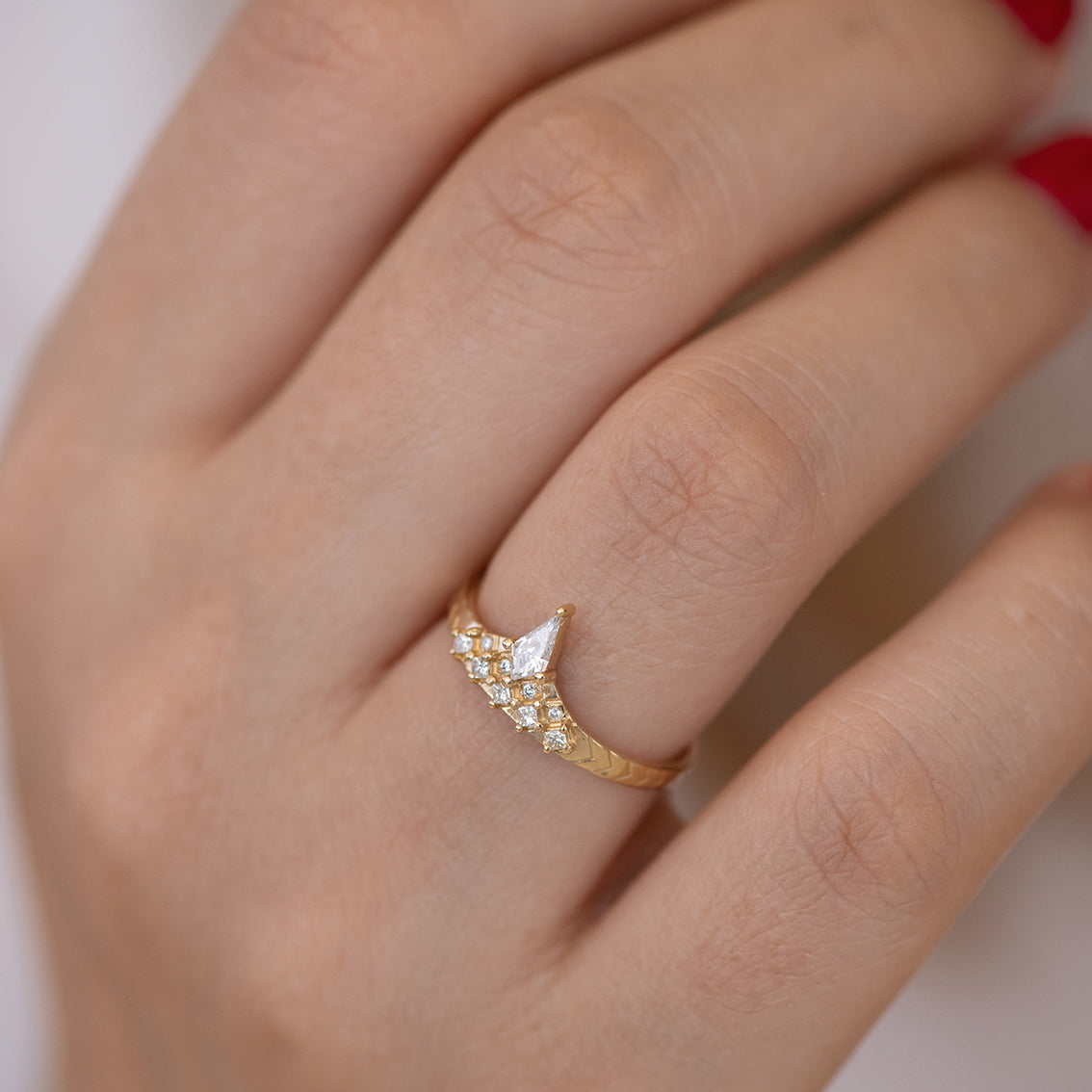 Geometric band with diamond peak alone on finger.jpg