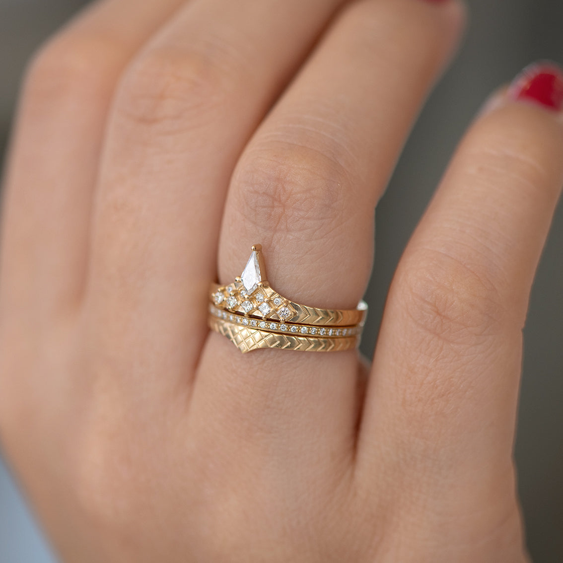 Geometric band with diamond peak on finger