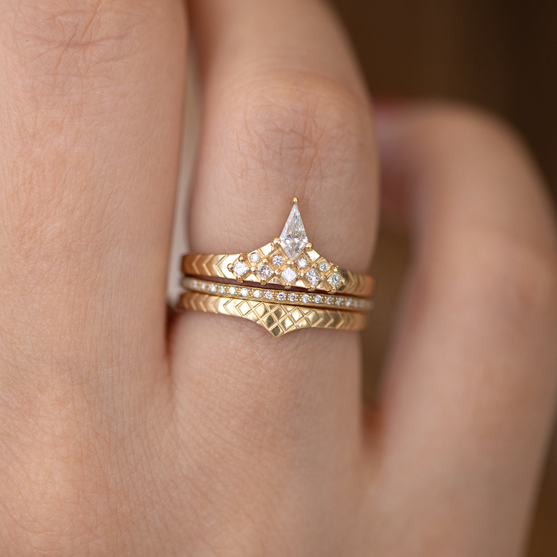 Geometric band with diamond peak on hand