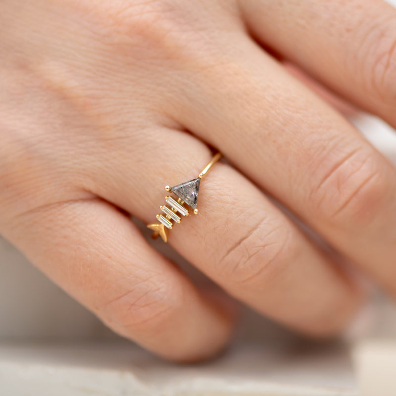 Gold-Fish-Bone-Ring-with-Triangle-and-Baguette-Cut-Diamond-on-finger