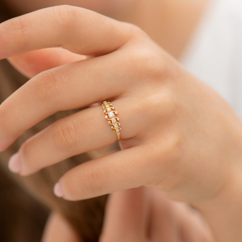 Gold-Orbit-Ring-with-Brilliant-Cut-White-Diamonds-on-finger