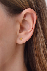 Gold Stud Earring - Arrow Earring on Ear Detail Shot