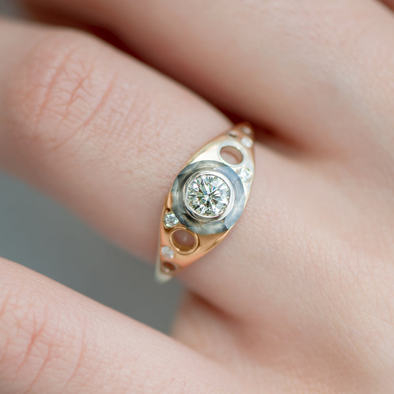 Golden-Grommet-Ring-with-a-Fancy-Green-Diamond-and-Grey-diamond-Sphere-top-shot