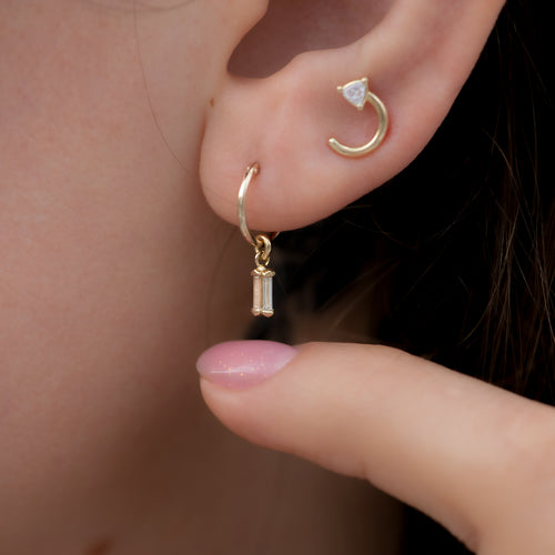 Golden-Hoop-Earrings-with-a-Diamond-Lantern-Pendant-Earlobe