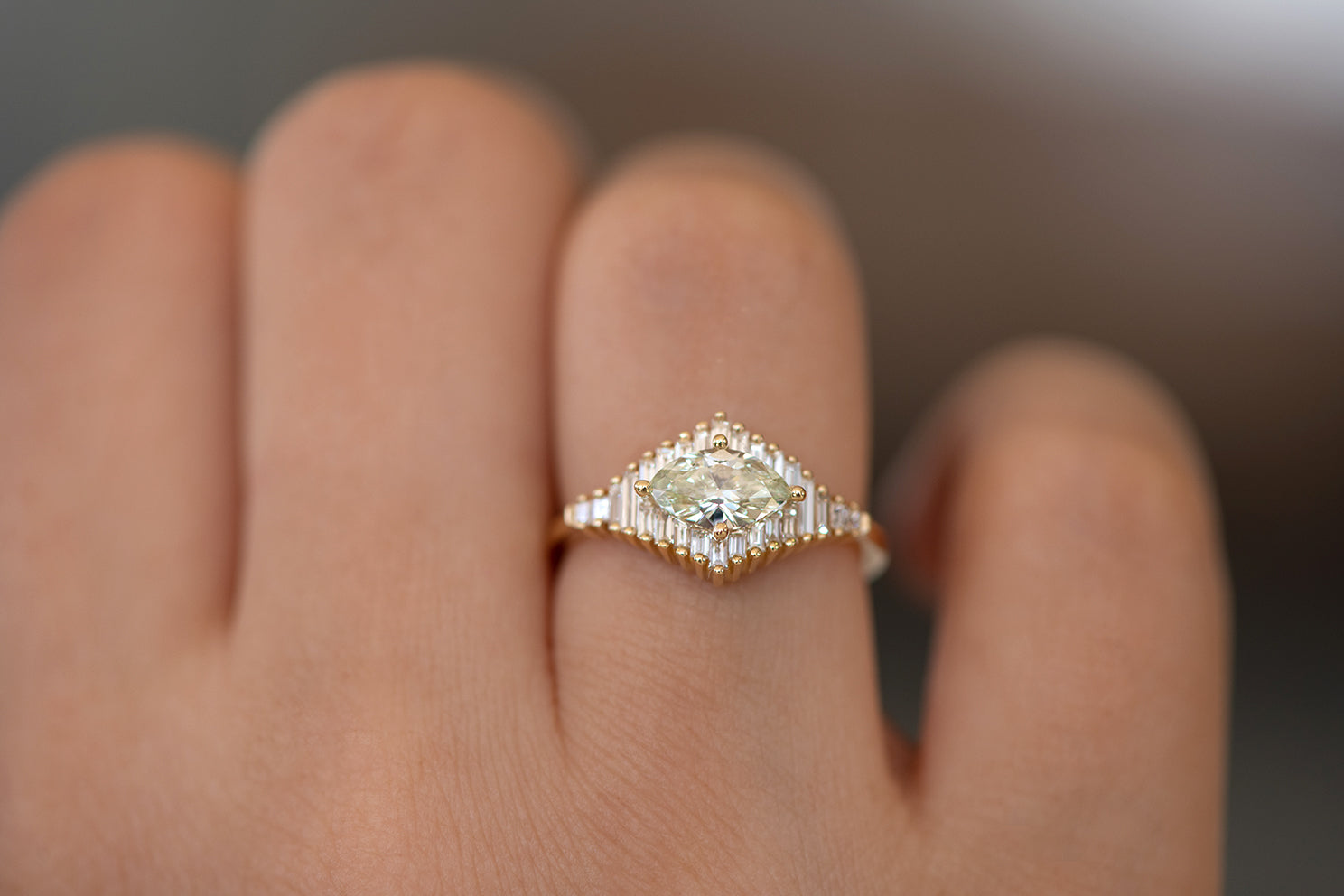 Green Diamond Engagement Ring with Baguette Diamonds - Fancy Color Diamond Ring on hand up close lower angle