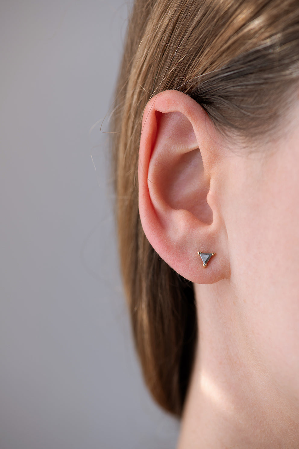 Grey Triangle Diamond Stud Earrings Front View on Ear