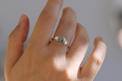 Cluster engagement ring on finger