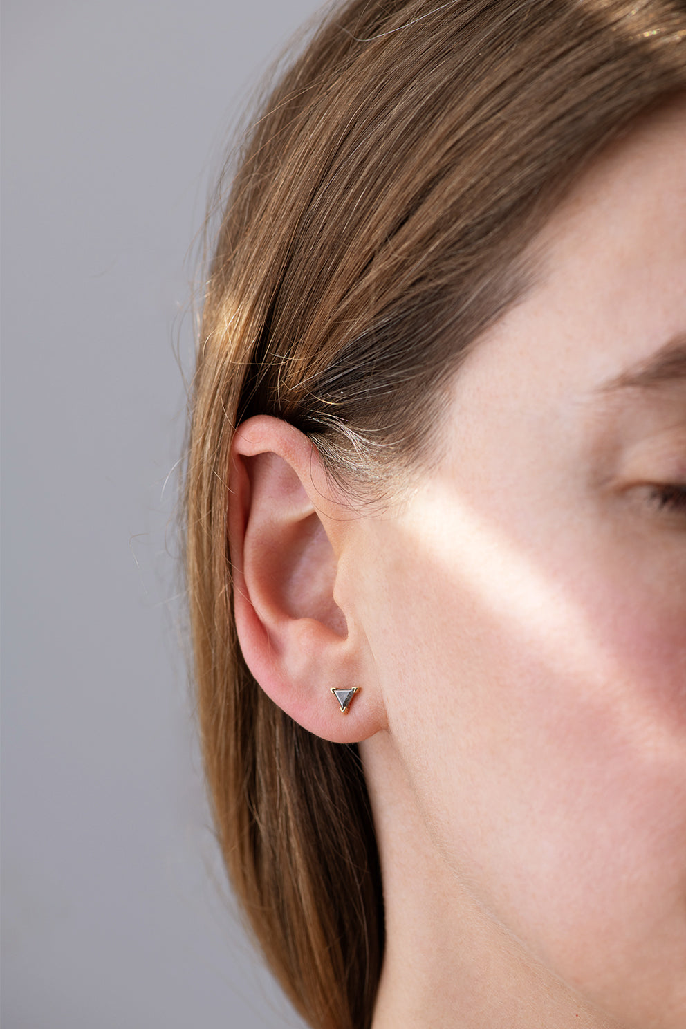Grey Triangle Diamond Stud Earrings on Ear Side View