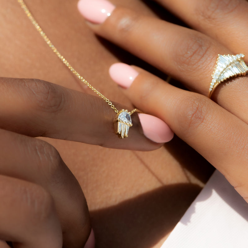Half-Moon-Diamond-and-Gold-Necklace-The-Moon-Beam-on-finger