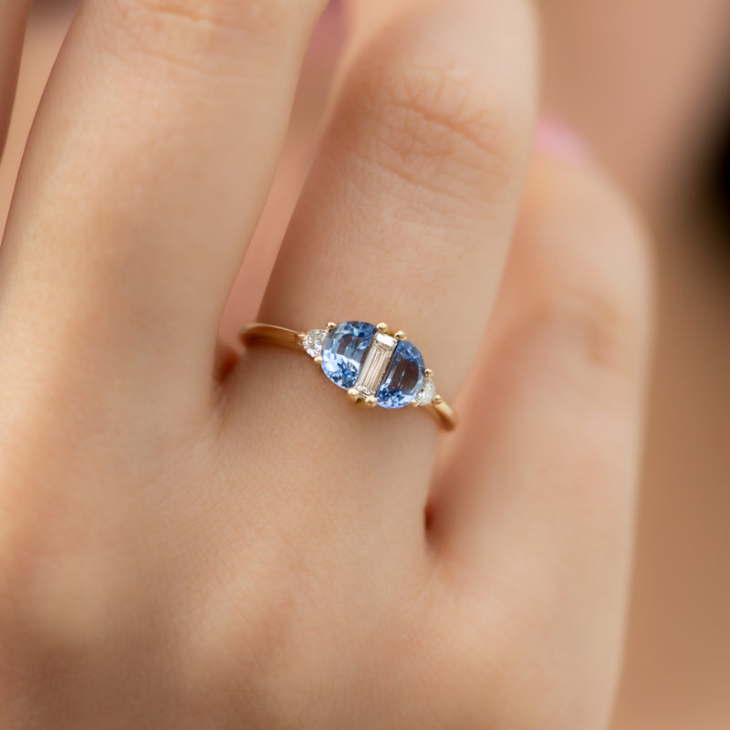 Half-Moon-Sapphire-Engagement-Ring-with-Baguette-Cut-Diamond-on-finger-side-shot
