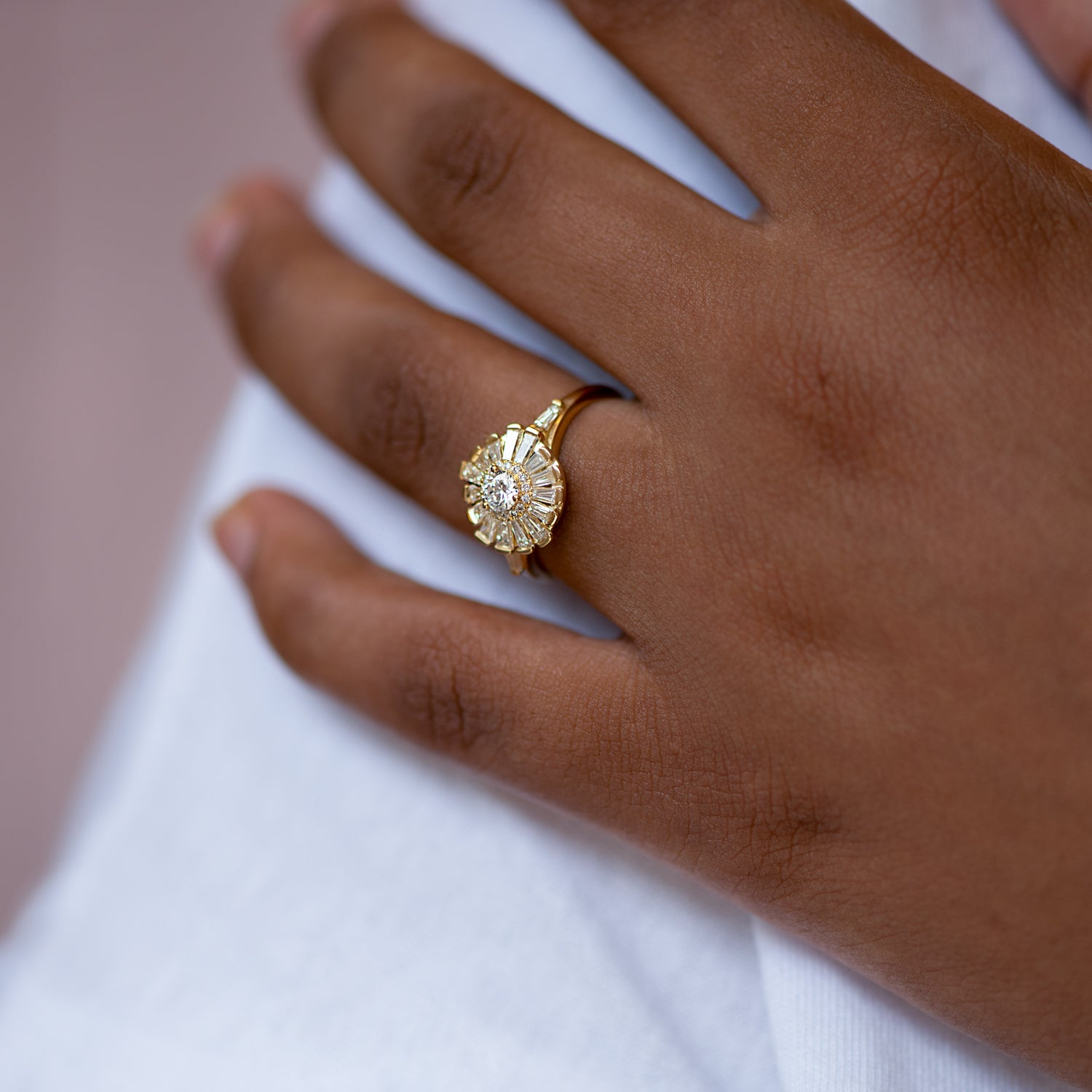 Halo-Ring-with-Baguette-Diamond-Frills-Asymmetric-Halo-Engagement-Ring-on-finger