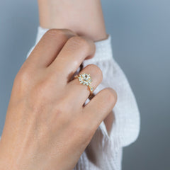 Hexagon-Engagement-Ring-with-Multiple-Cut-Diamond-Petals-in-hand