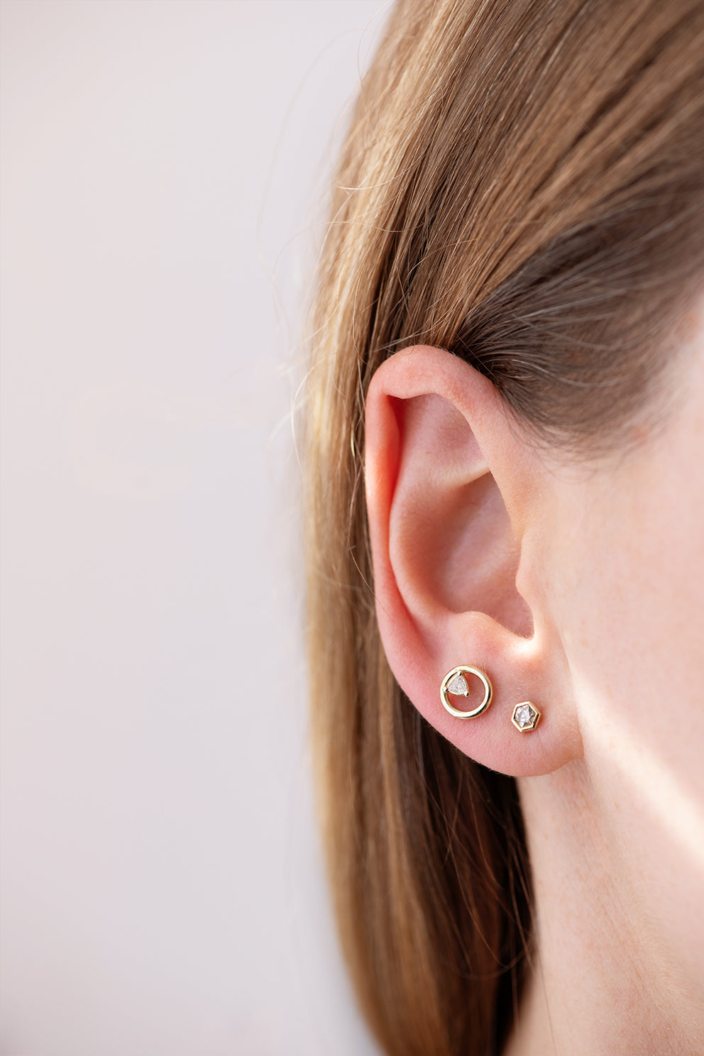 Hexagon Diamond Earrings on Ear
