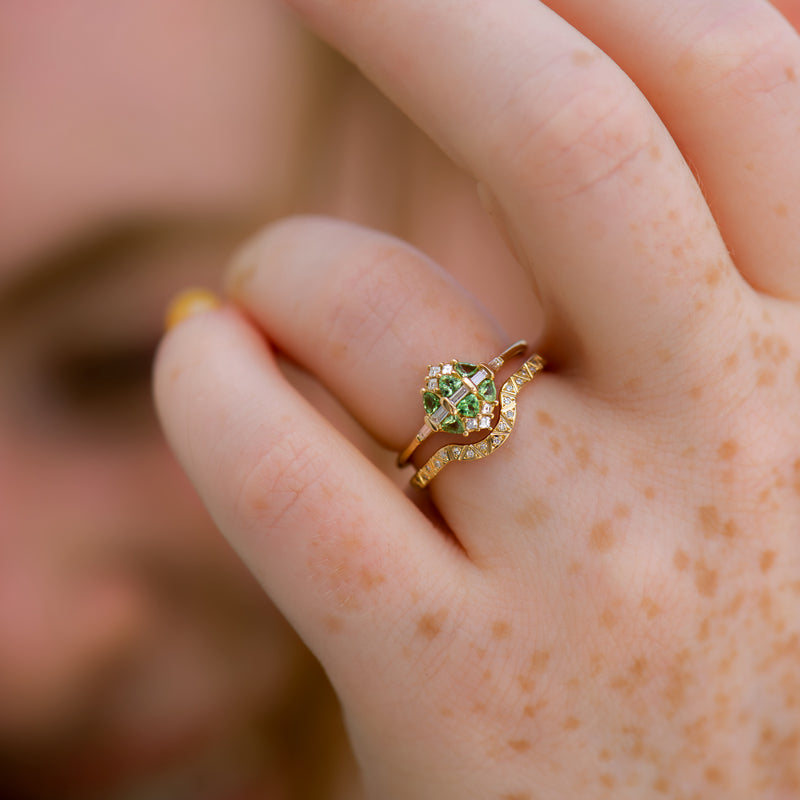 Mint-Garnet-and-Diamond-Cluster-Engagement-Ring-on-finger