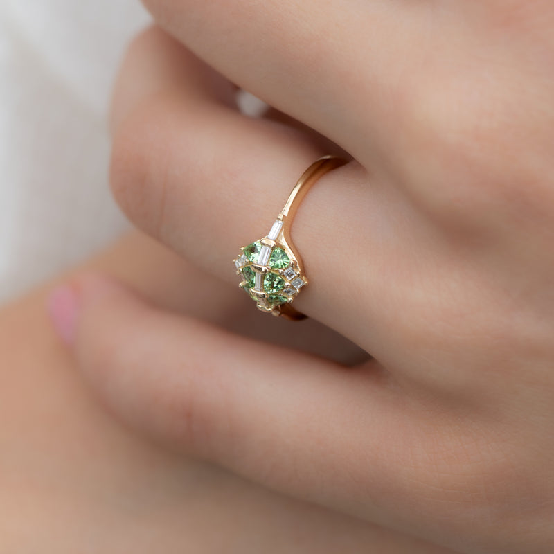 Mint-Garnet-and-Diamond-Cluster-Engagement-Ring-side-shot-on-finger